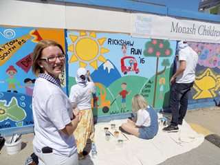 PPG Paint Volunteers Help Kids Paint Mural
